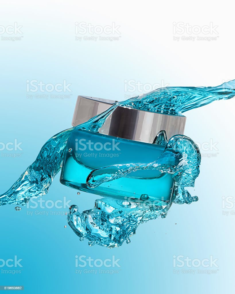 The jar of moisturizing gel with blue water splash stock photo