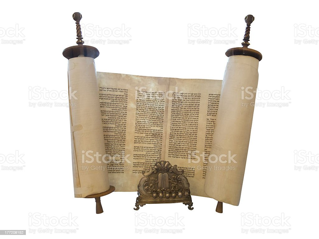 The Jewish Torah scroll and a gold menorah candle support stock photo