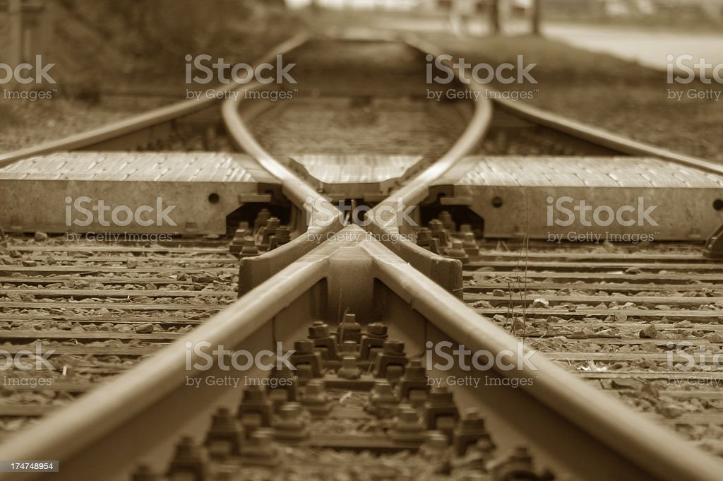 The joining of two railroads tracks into one stock photo