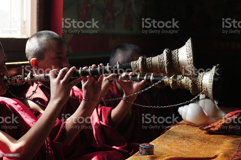The Jonangpa monk students playing woodwind instruments royalty-free stock photo