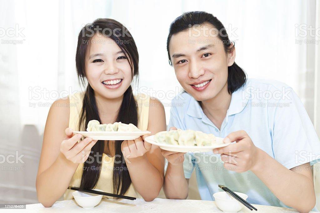 The joy of eating dumplings stock photo