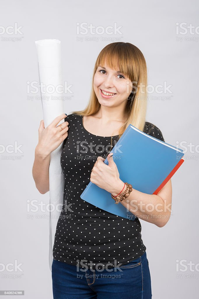 The joyful girl with roll of drawings folder in hands stock photo