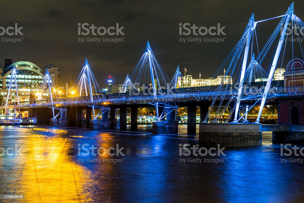 The Jubilee Bridge in London at night stock photo