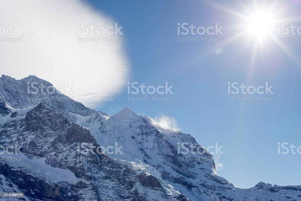 The Jungfrau Mountain Peak on a Foehn wind day. stock photo