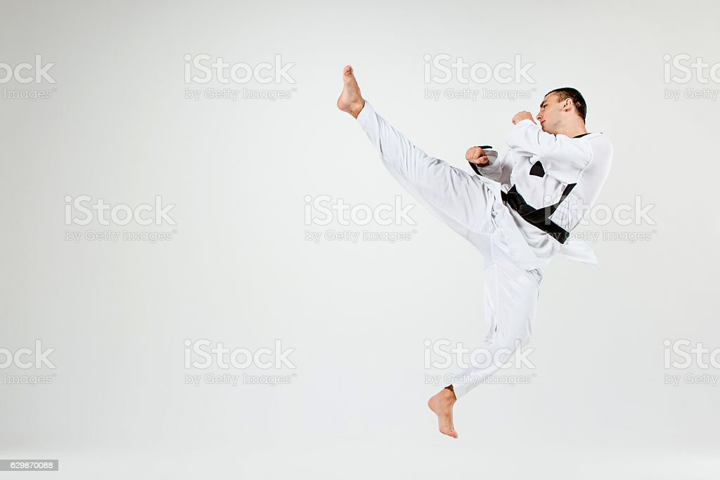 The karate man with black belt stock photo
