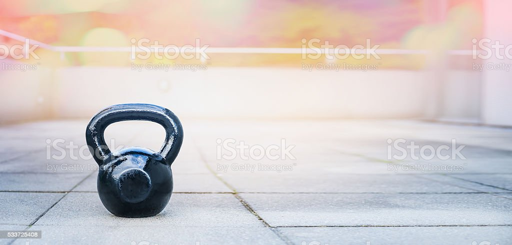 the kettlebell for outdoor sports, stands  terrace of the house stock photo