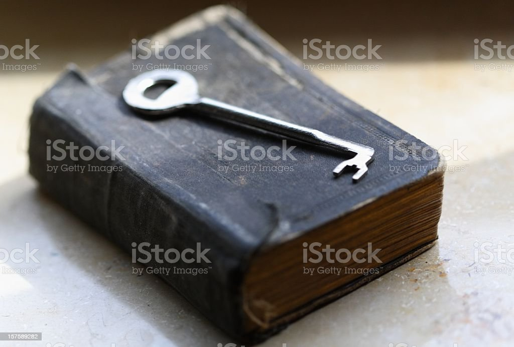 The key lying on old book / bible stock photo