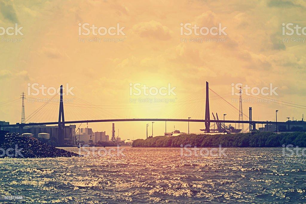 The Köhlbrand-bridge in Hamburgs port-area at sunset stock photo