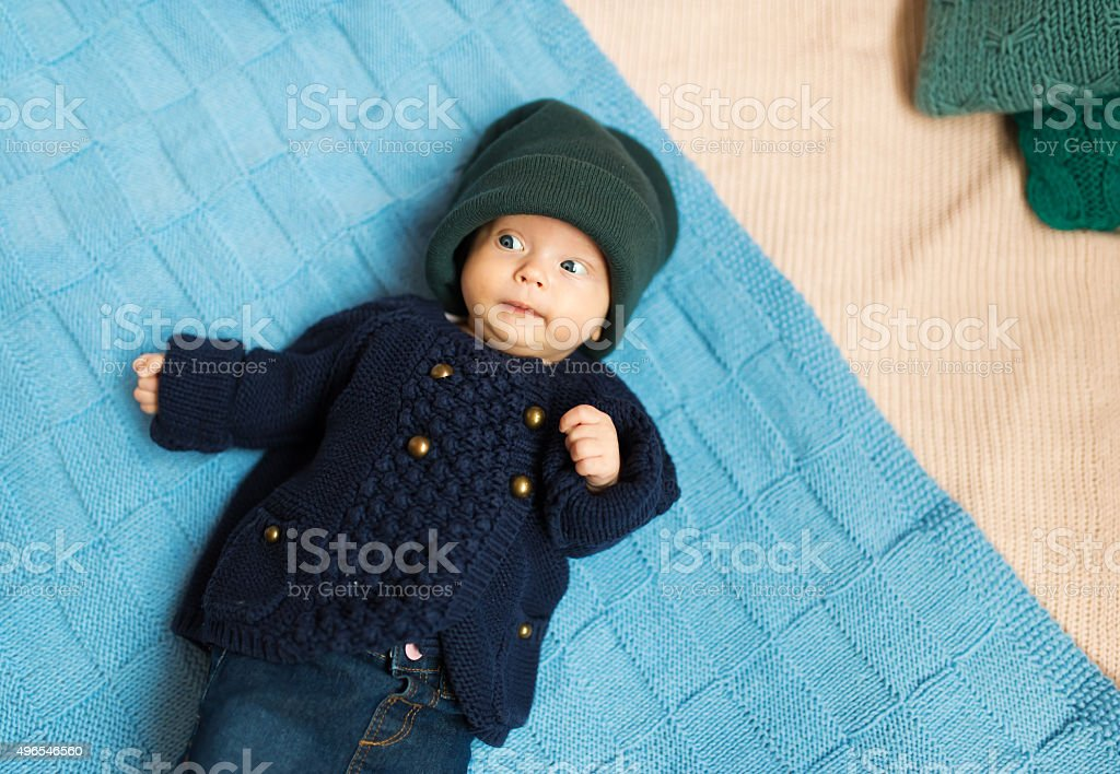 the kid lies on a cover stock photo