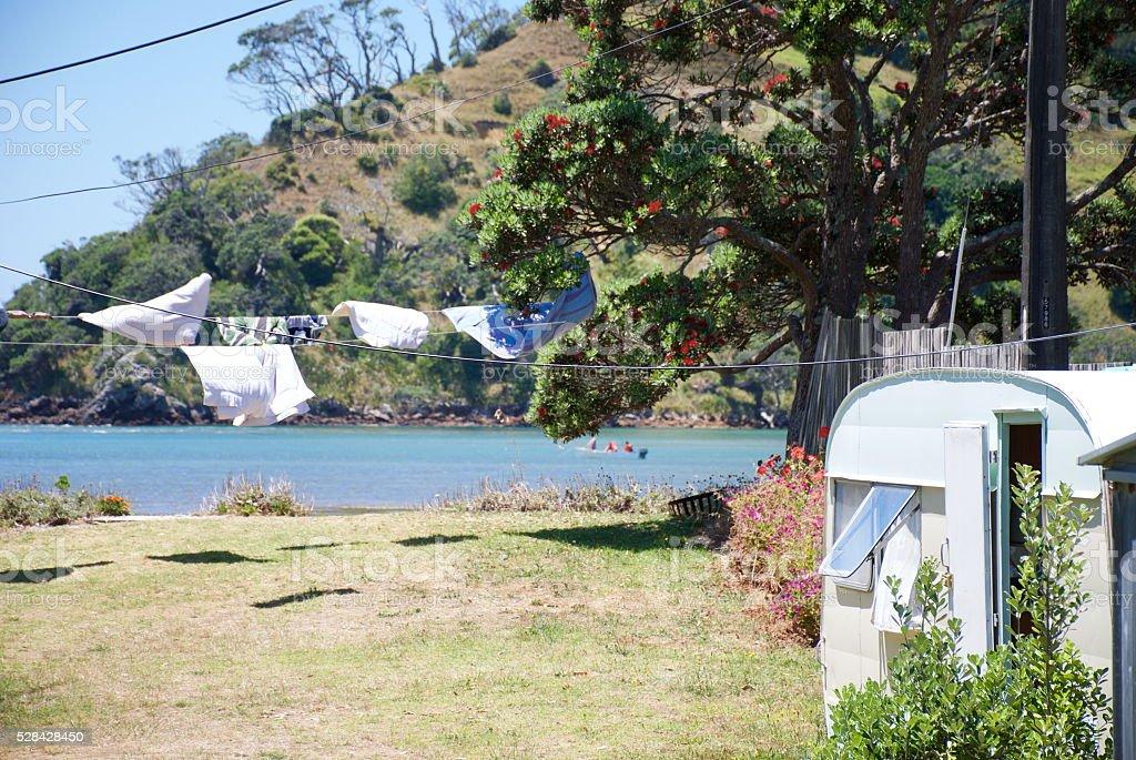 The Kiwi Summer; Caravan by Sea and Washing stock photo