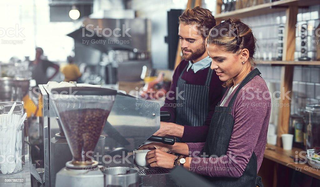 The know their way around a coffee machine stock photo
