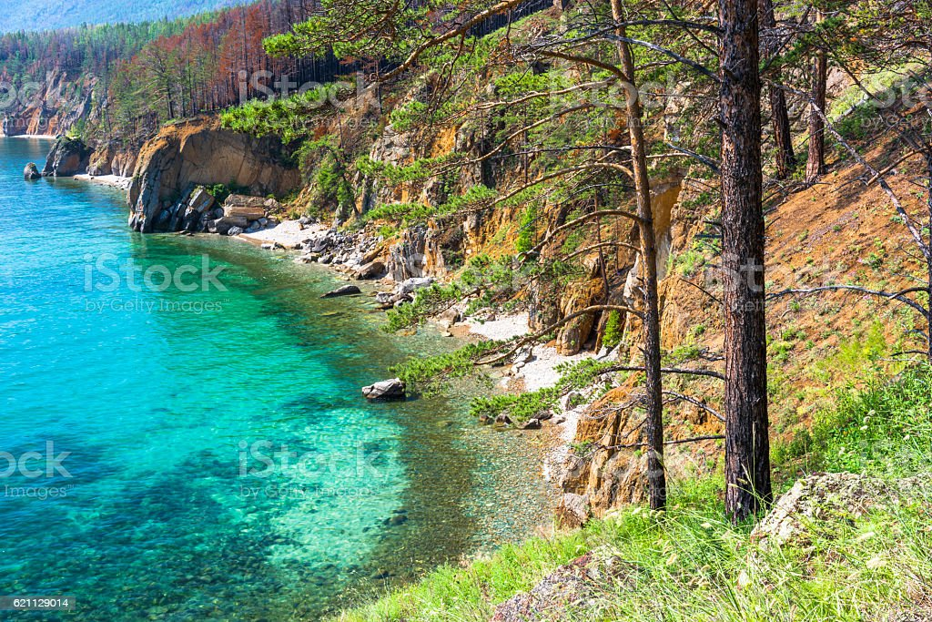 The lagoon is surrounded by rocky shores stock photo