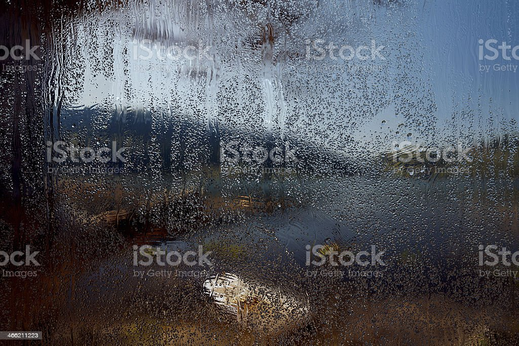The lake scene through a rain drenched window royalty-free stock photo
