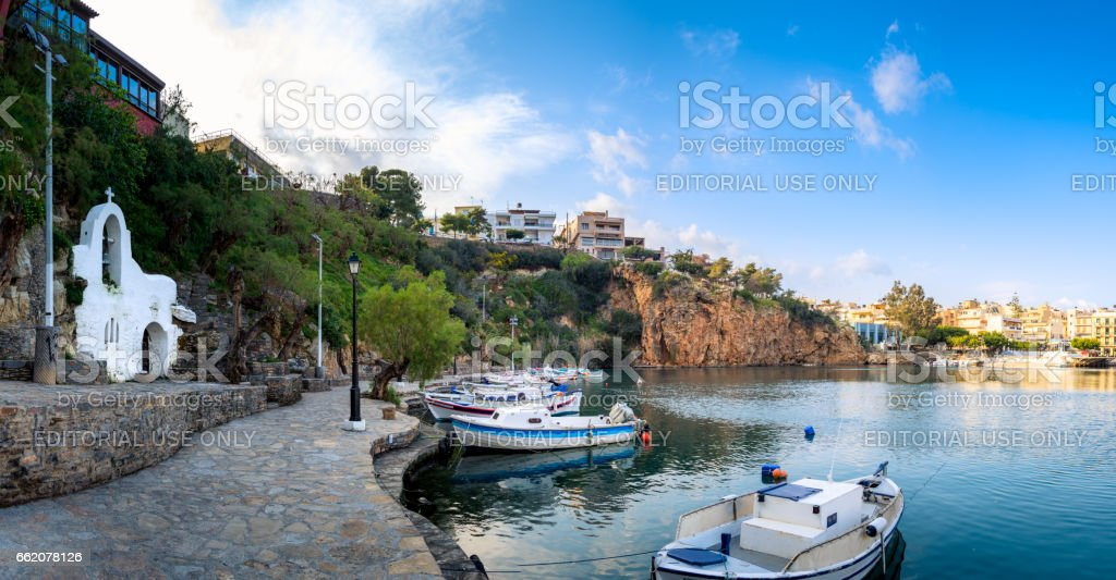 The lake Voulismeni in Agios Nikolaos,  a picturesque coastal town with colorful buildings around the port in the eastern part of the island Crete, Greece stock photo