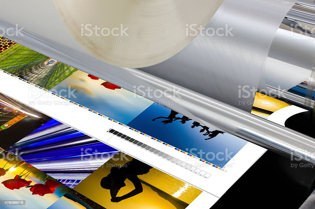 The laminator equipment for press in a modern printing house stock photo