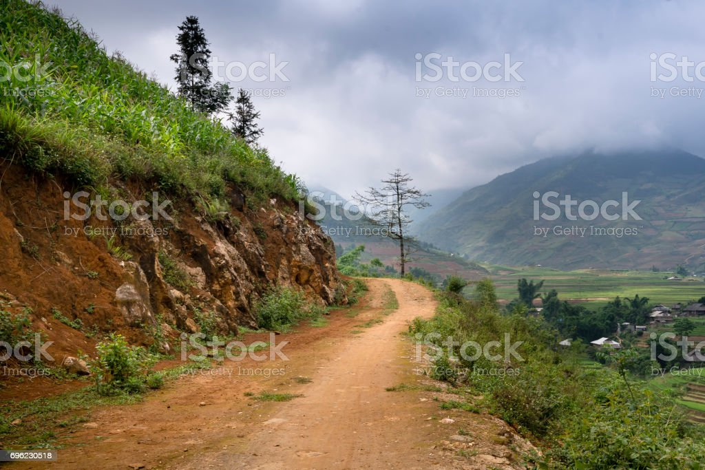 The land road enters the village on mountain at Lao Cai province, Viet Nam stock photo