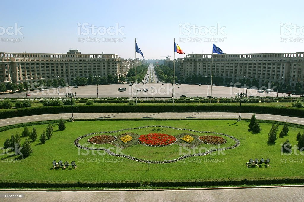 The landscape of Bucharest and its flags stock photo