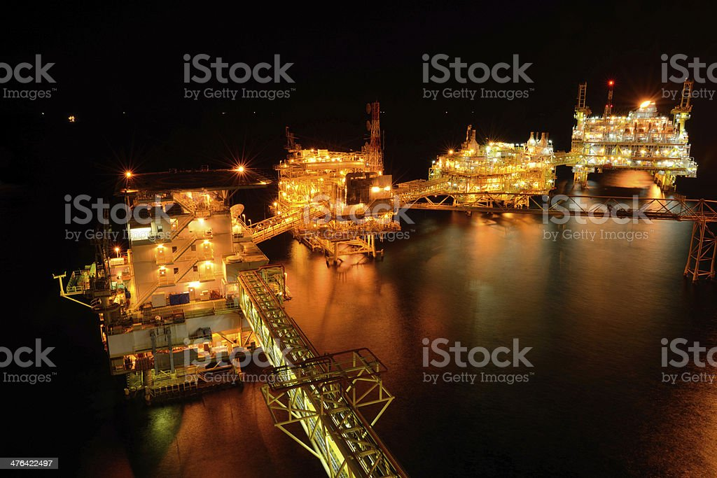 The large offshore oil rig at night royalty-free stock photo
