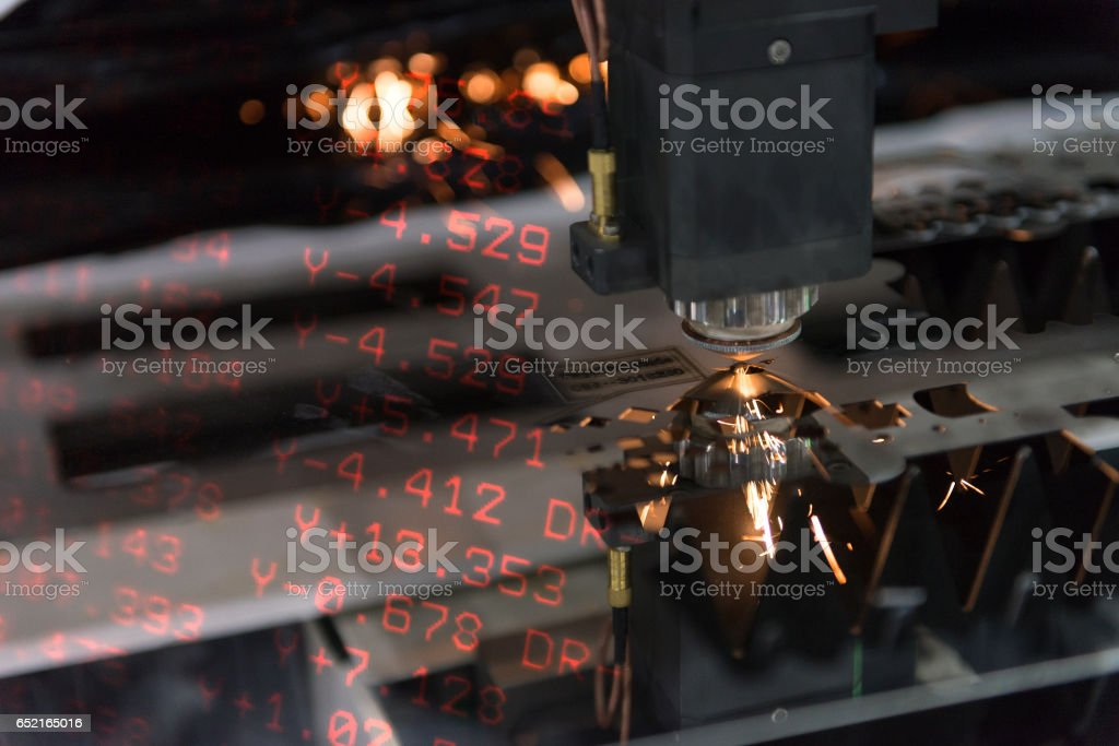 The laser cutter machine  cutting the sheet metal and the numerical of positioning.Abstract scene of Laser cutting machine and the CNC nemerical display stock photo