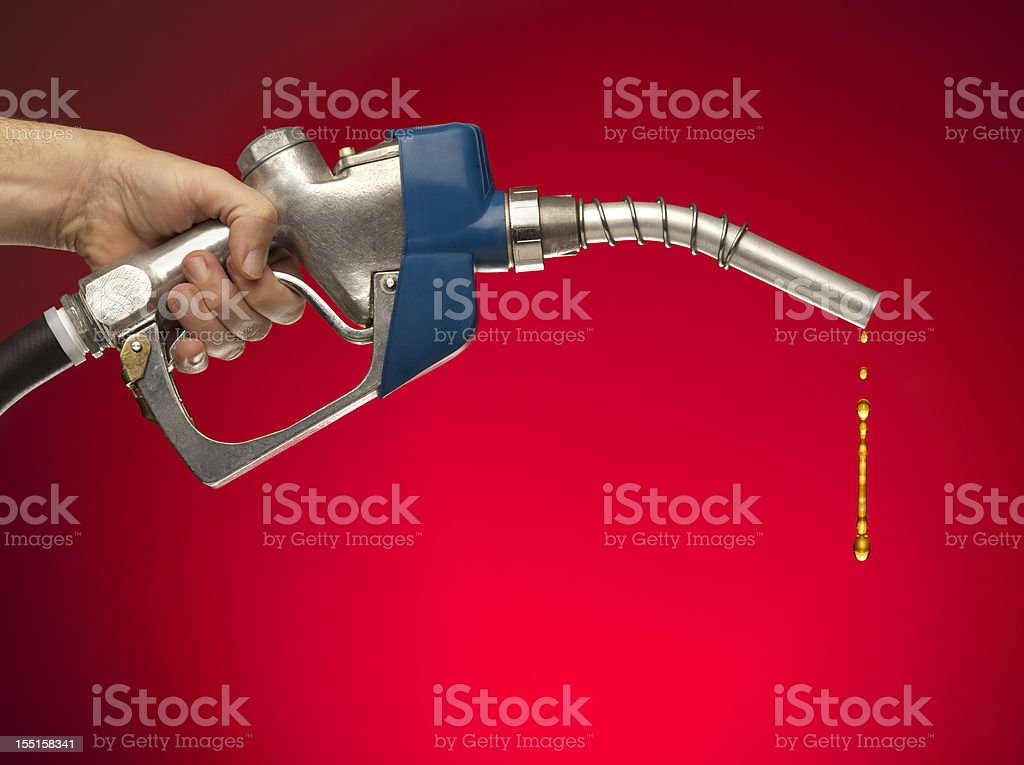The Last Drops of Gasoline Dripping From Nozzle royalty-free stock photo