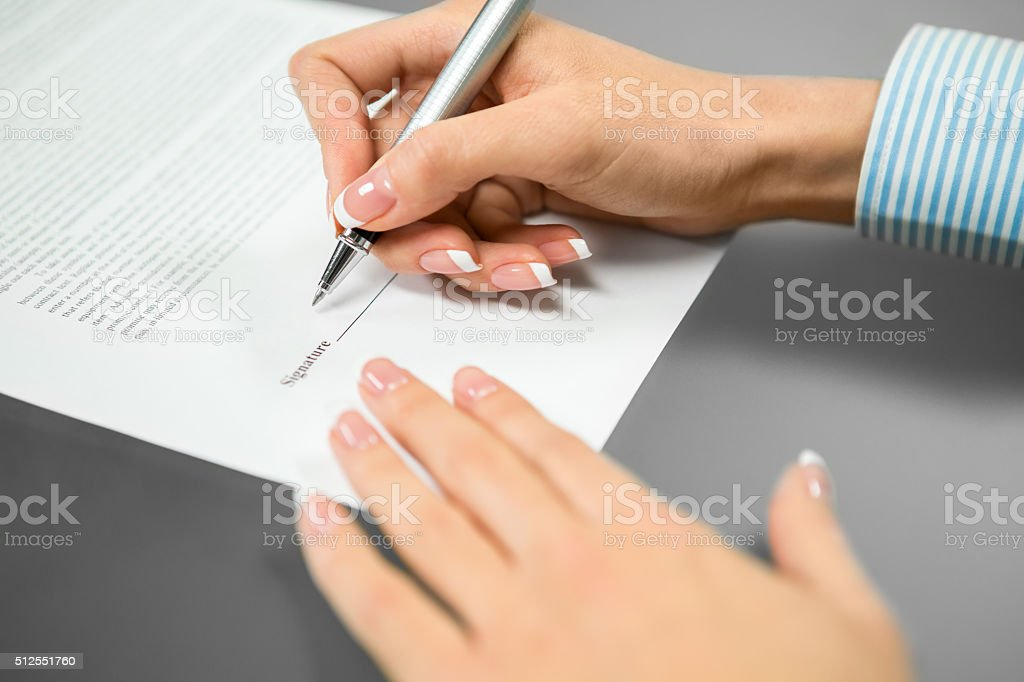 The last signature needed. stock photo