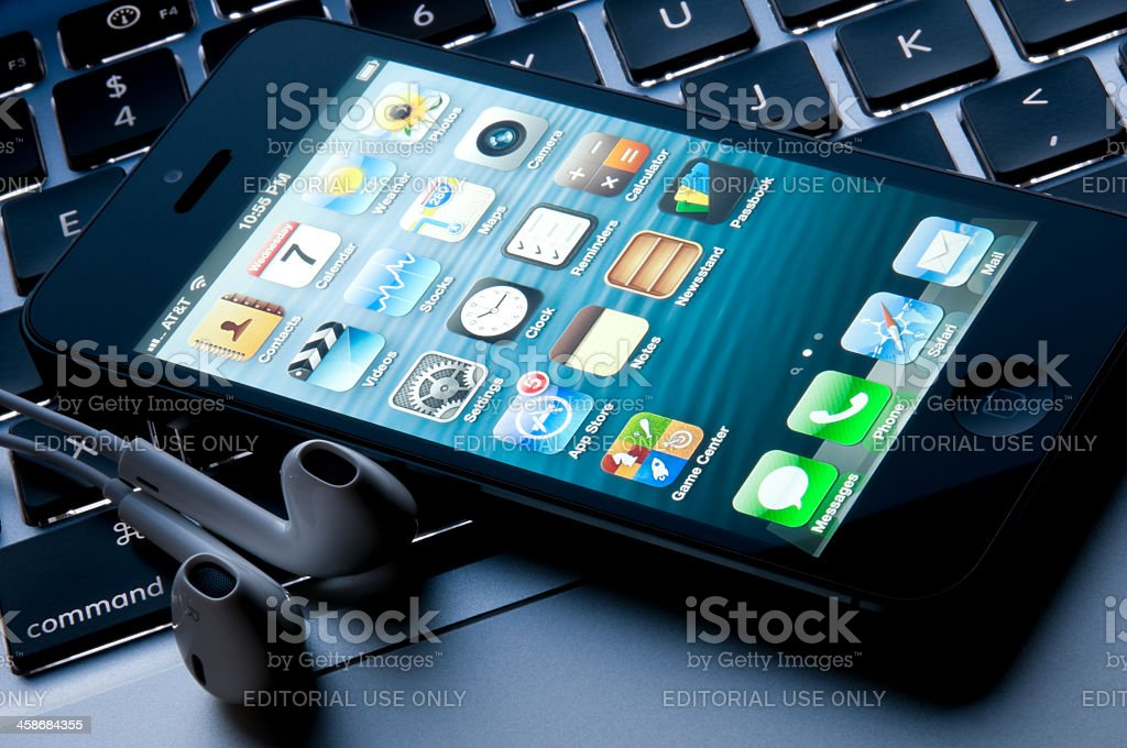 The latest Apple Iphone 5 with redesigned earphones royalty-free stock photo