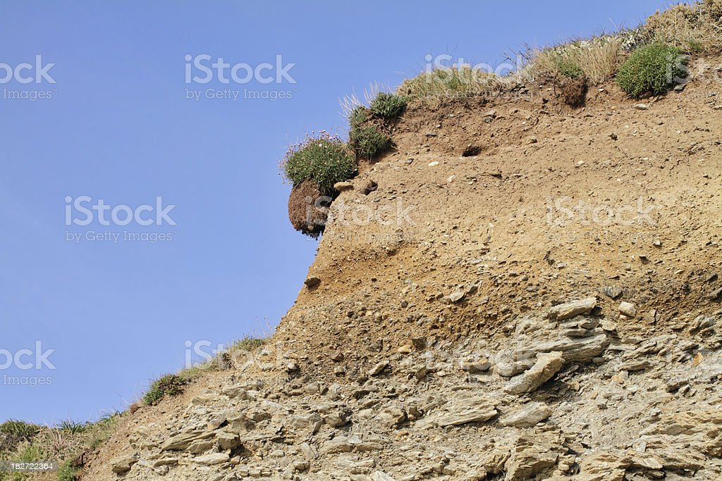 Full soil profile of cliff at on Cornwall coastal path stock photo