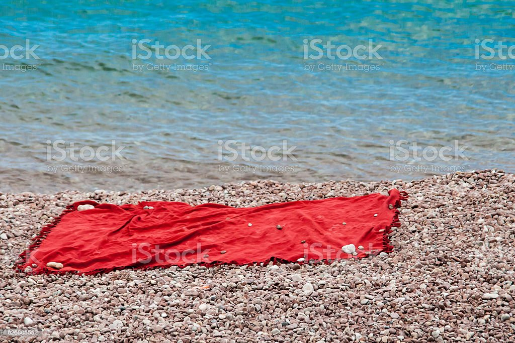 the laying lying on pebble beach stock photo