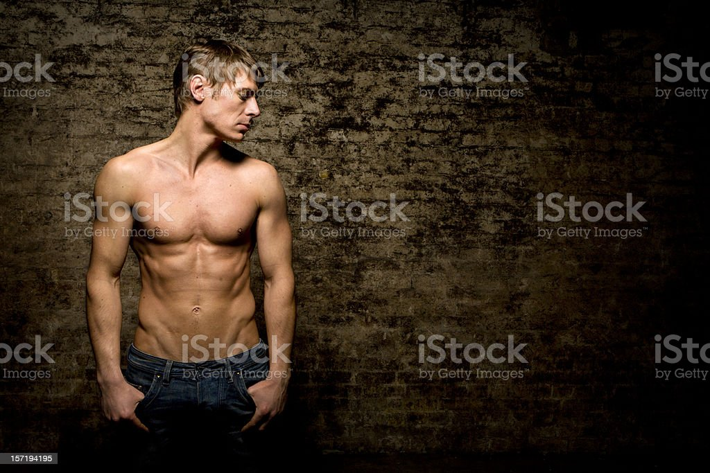 the lean physique of a healthy young adult male royalty-free stock photo