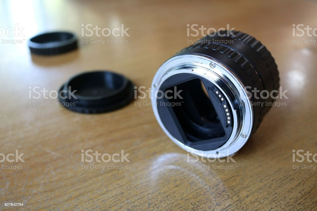 The lens adapter for macro photography stock photo