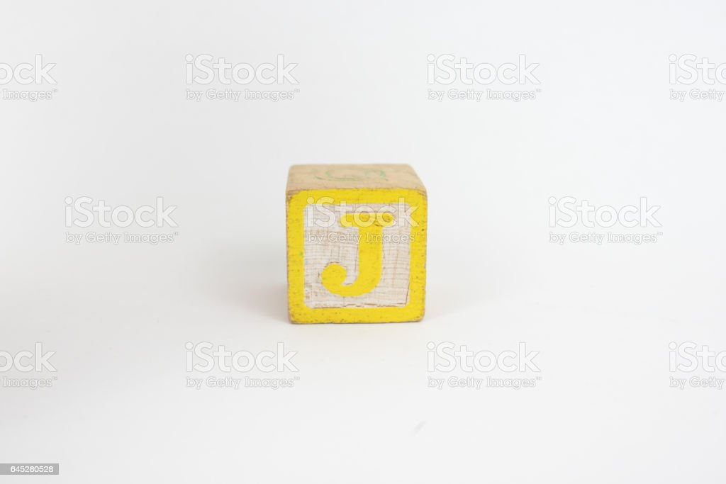 The Letter J in Colorful Wooden Children's Blocks stock photo