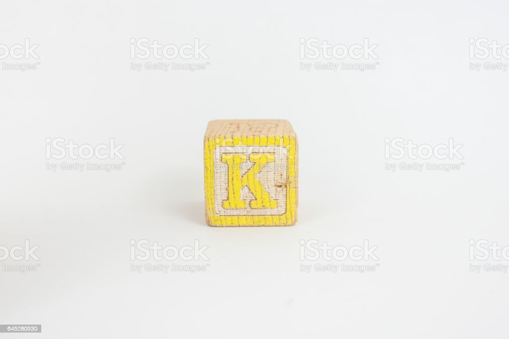 The Letter K in Colorful Wooden Children's Blocks stock photo