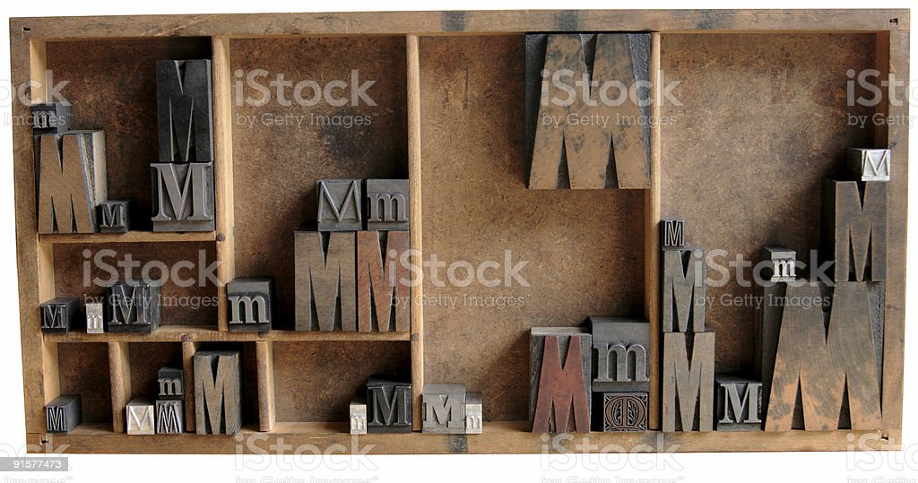 the letter M in a type case stock photo