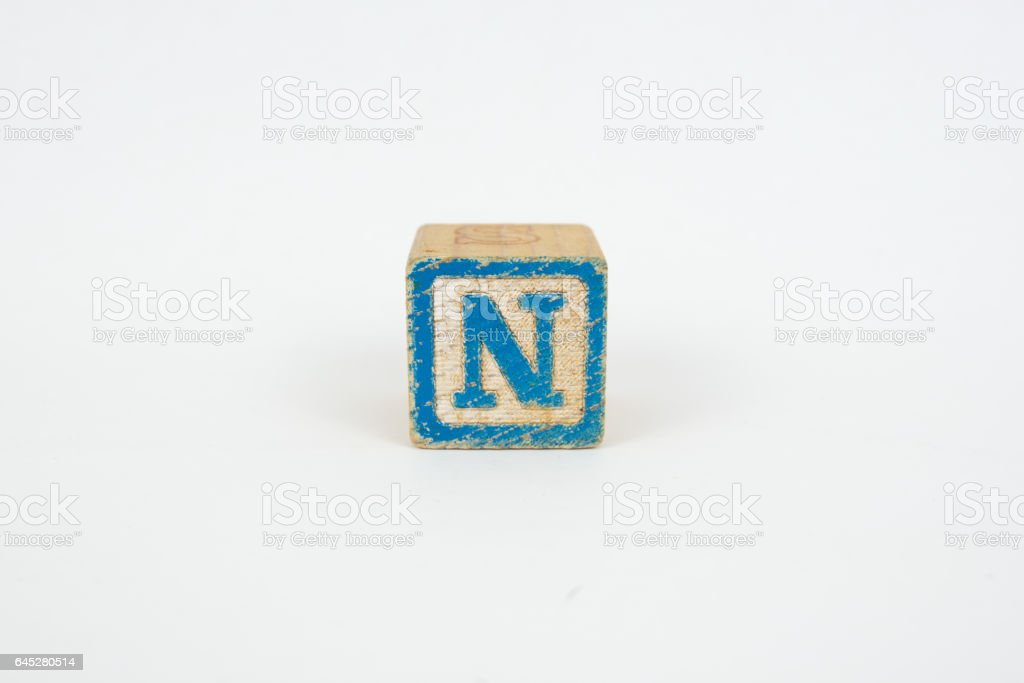 The Letter N in Colorful Wooden Children's Blocks stock photo