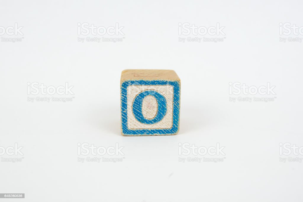 The Letter O in Colorful Wooden Children's Blocks stock photo