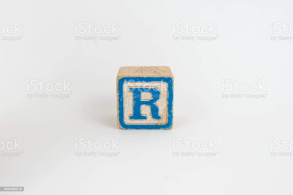 The Letter R in Colorful Wooden Children's Blocks stock photo