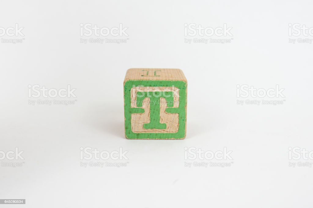 The Letter T in Colorful Wooden Children's Blocks stock photo