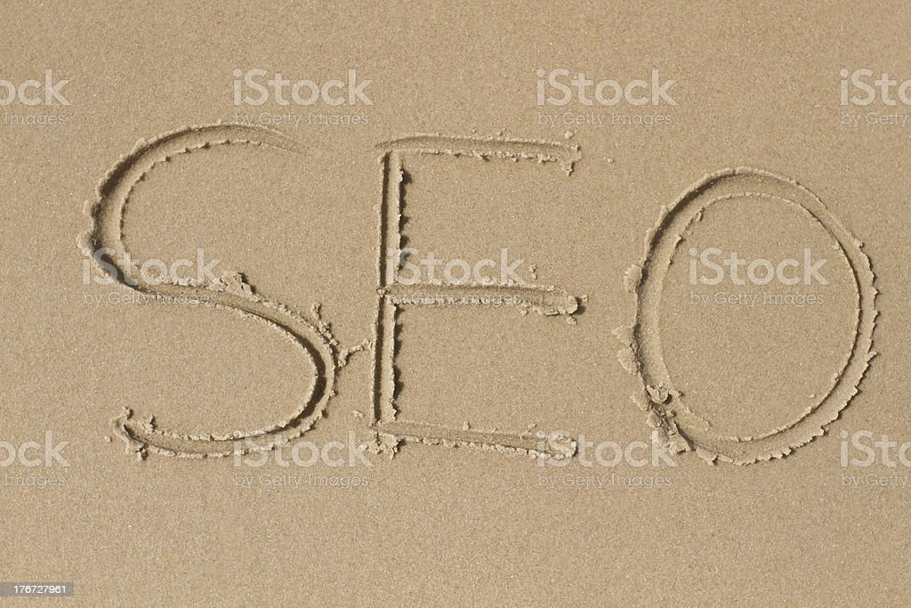 The letters S E O drawn in sand royalty-free stock photo