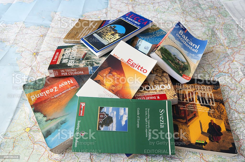 The library of a perfect traveler, guides and maps stock photo