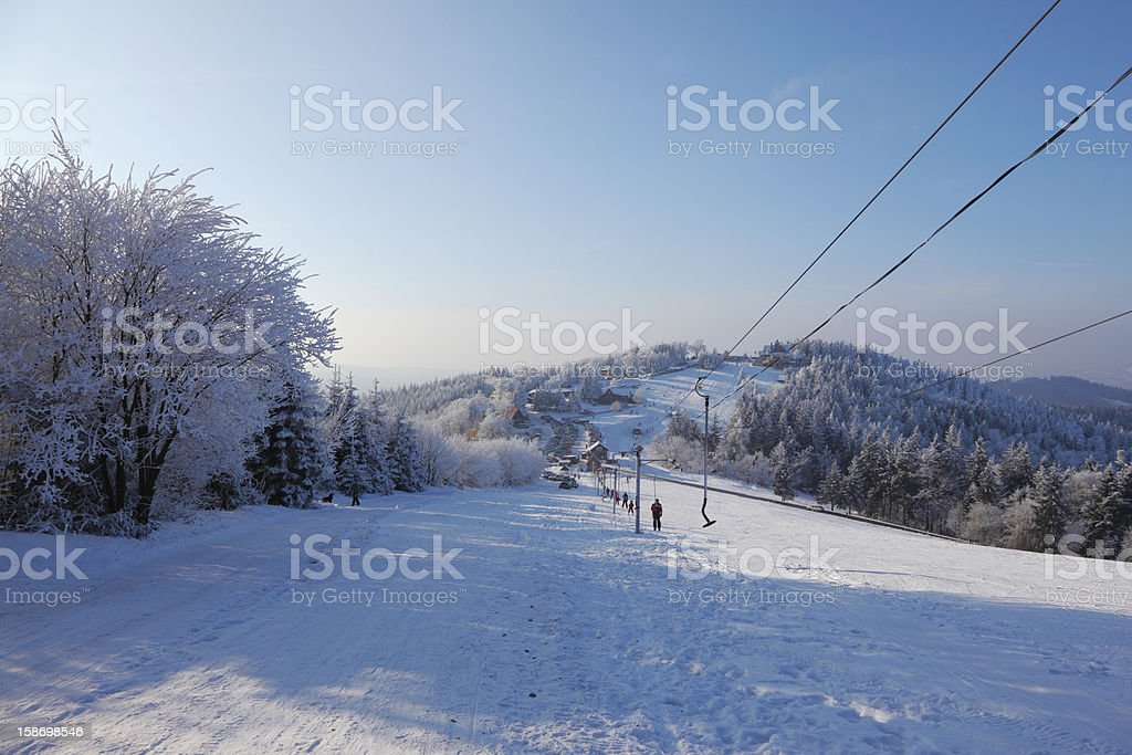 The lift cableway and a lot of skiers royalty-free stock photo