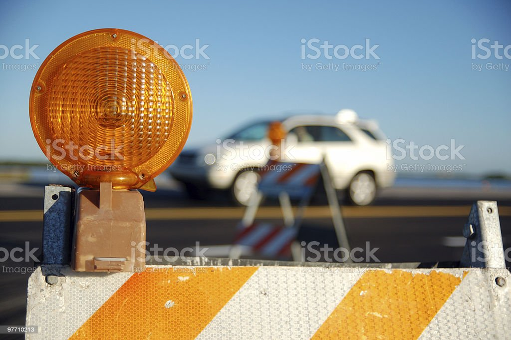 The light on a construction barrier on a road stock photo