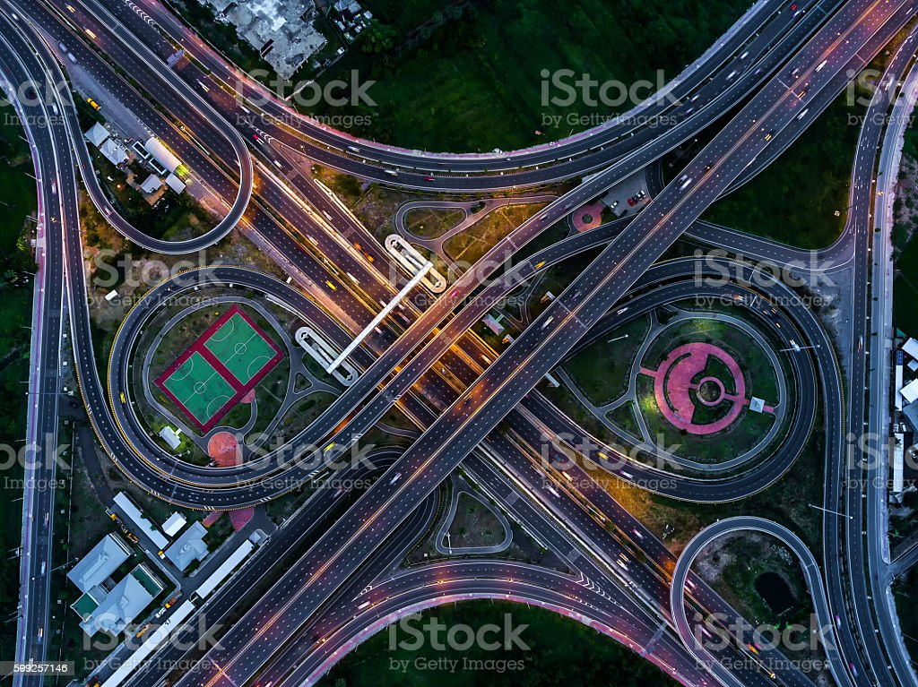 The light on the road at night and the city stock photo