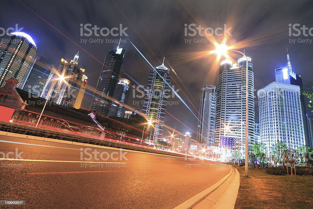 The light trails on modern office building background in shanghai royalty-free stock photo