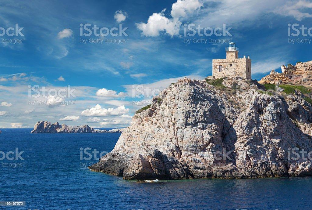 The lighthouse of Greek island Ios stock photo
