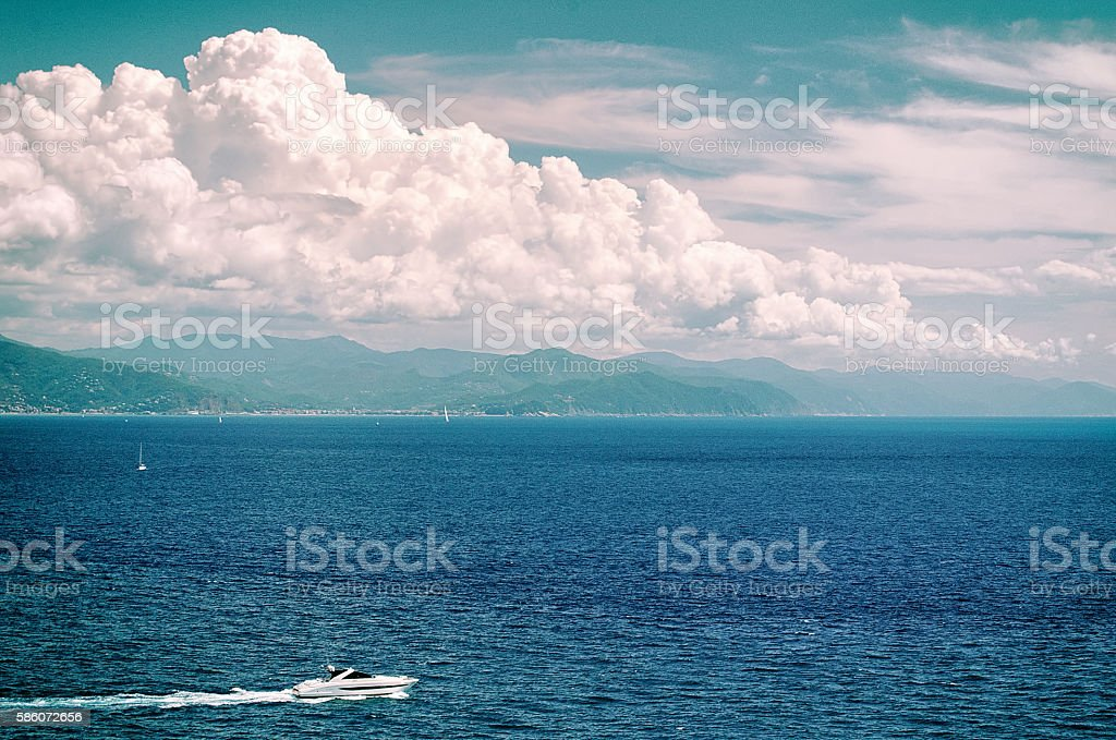 The Ligurian Sea and a single speedboat in the foreground stock photo