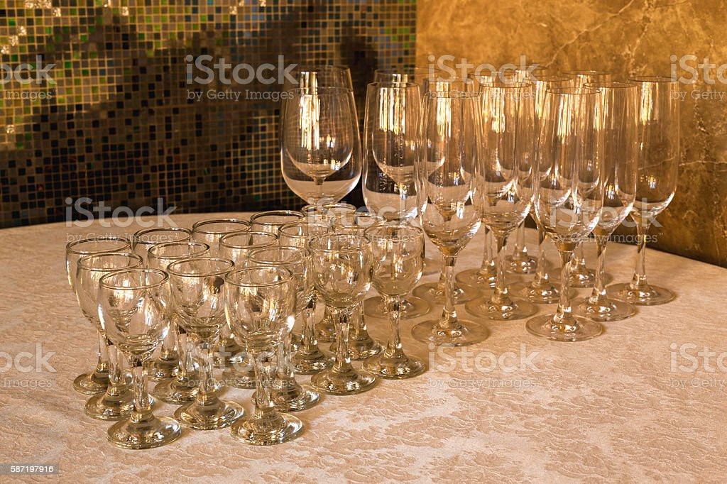 The line of empty stemware at the table in restaurant. stock photo