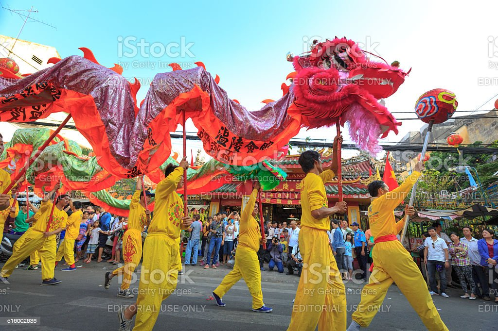 the lion dance ceremony of Chinese Vietnamese people in HCMC stock photo