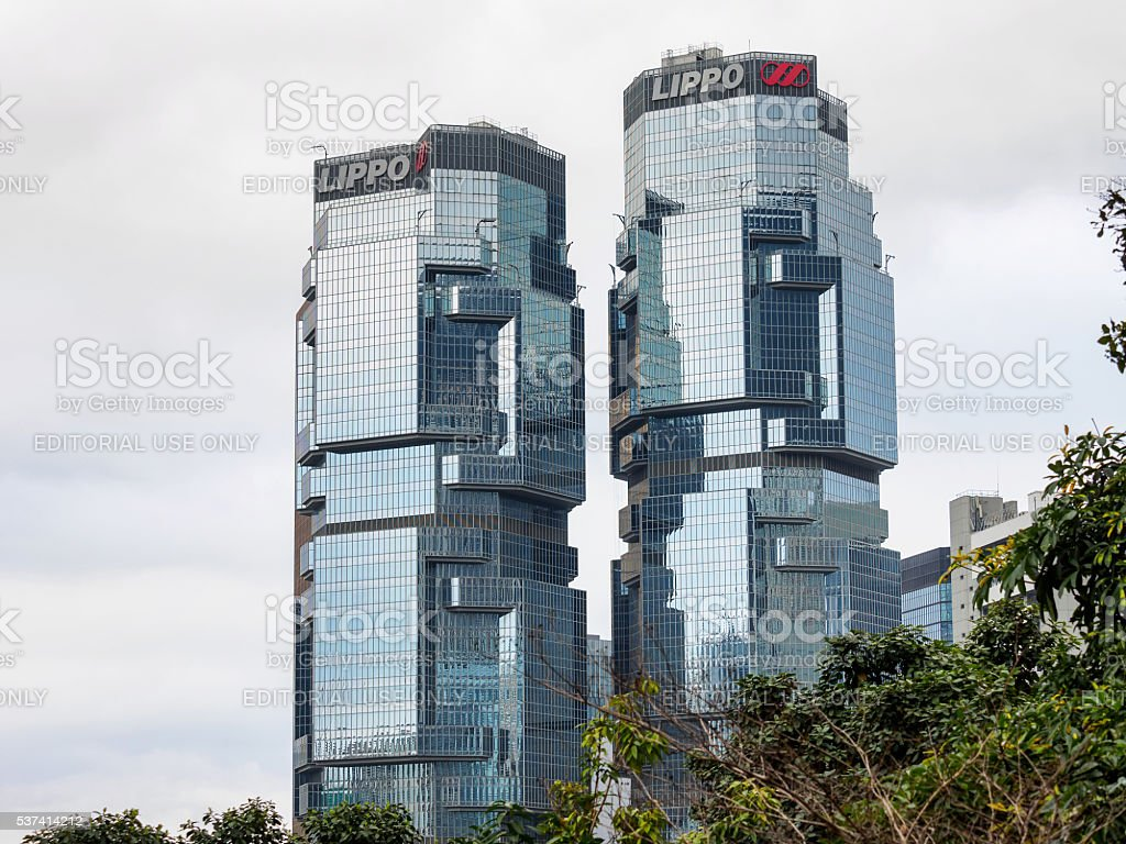 The Lippo Centre is a twin-tower skyscraper. stock photo