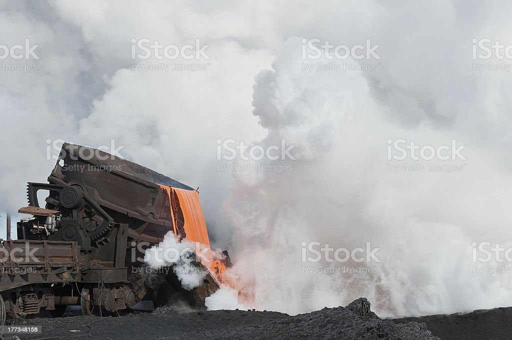 The liquid molten slag and a cloud of hot steam stock photo