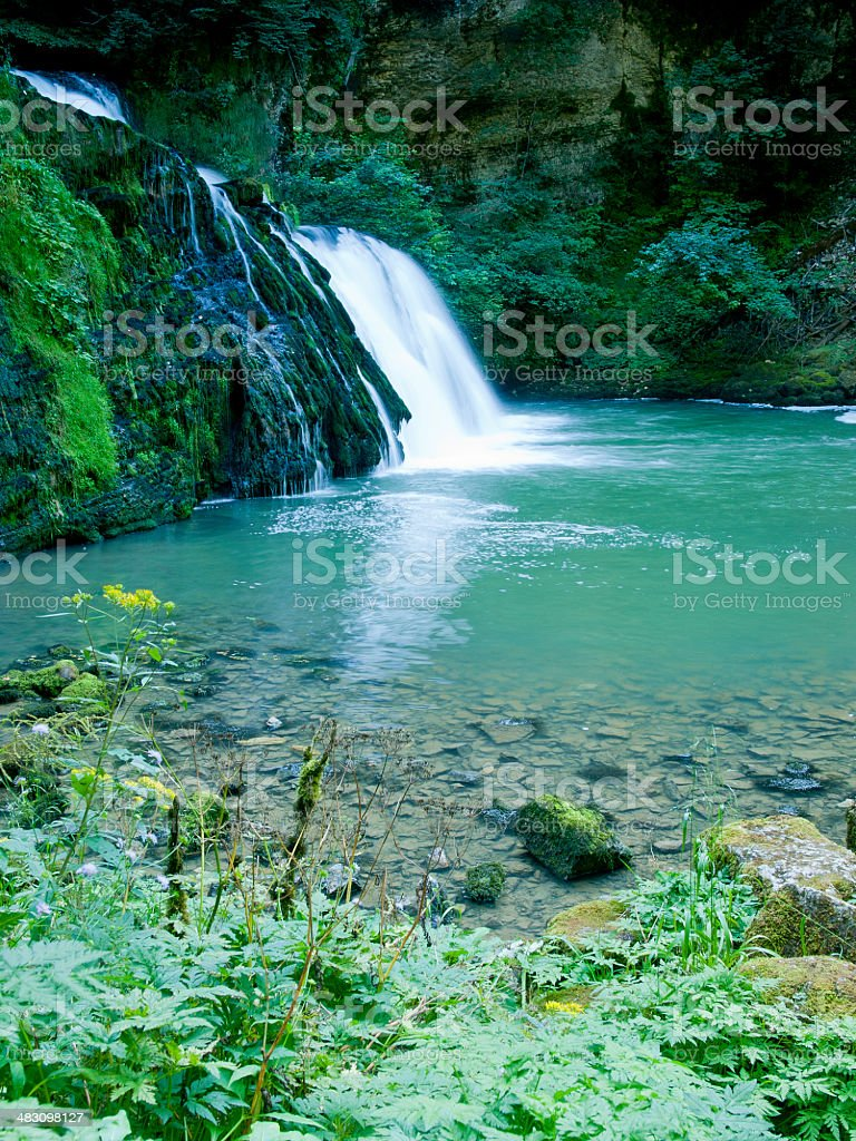 The Lison's source waterfall in Doubs, France stock photo
